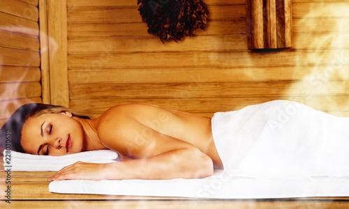 Leinwanddruck Bild Young woman relaxing in spa