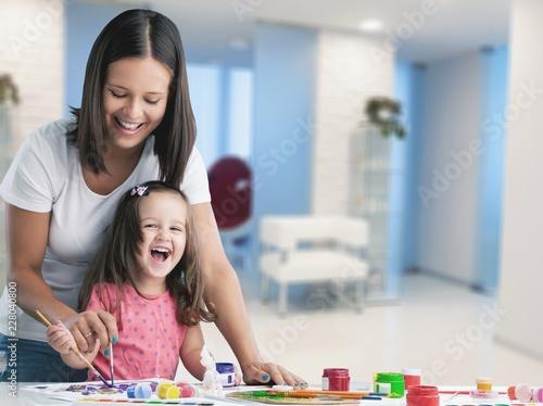 Leinwandbild Motiv Happy family kid mom babysitter parent teacher