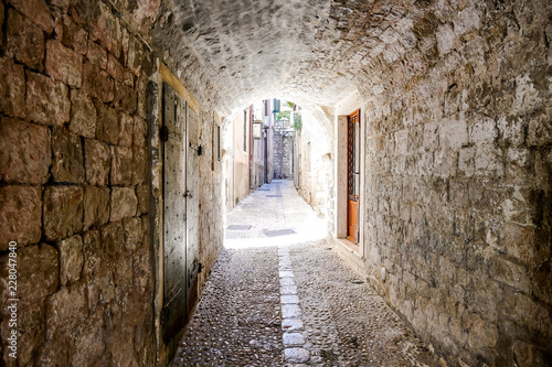 narrow street in old town of dubrovnik croatia, digital photo picture as a background