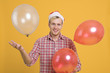 Quadro Man have fun in the party with balloon decoration on yellow background.