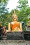 Large golden Buddha in lotus position in the temple Wat Phayam