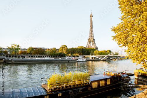 Landscape view of the riverside with Eiffel tower during the morning light in Paris - 228077611
