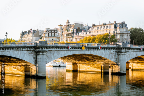 Foto Murales Landscape view of Concordia Bridge and residential buildings during the morning light in Paris