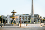 Maritime fountain on Concordia square with Luxor Obelisk on the background during the morning light in Paris