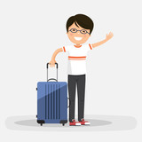 Isolated happy boy with blue suitcase on a white background