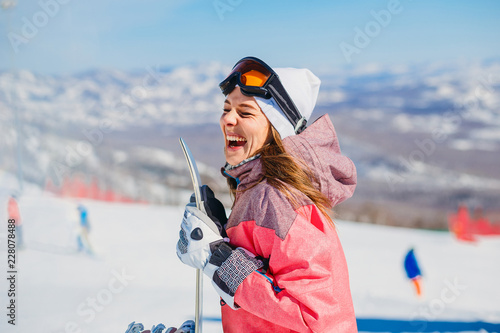 cheerful woman snowboarder laughs © Alyona
