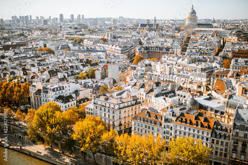 Wall mural Aerial panoramic view of Paris from the Notre-Dame cathedral during the morning light in France