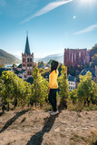 woman looking out over the village of Bacharach germany Middle Rhine Valley