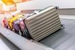 Leinwandbild Motiv Suitcase or luggage with conveyor belt in the airport