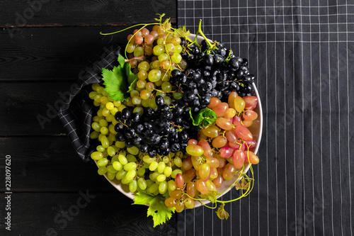 Foto Murales grape on wooden background