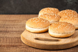 Burger buns on wooden table - 228102455