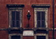 historical House Facade in Rome with a Seagull on a Lantern
