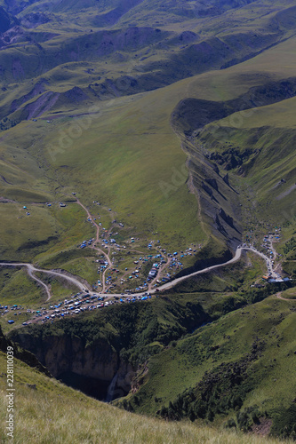 Populated valley in the North Caucasus in Russia. Houses among the hills and mountains. - 228110039
