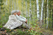 Portrait of old couple at park on autumn background