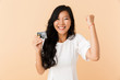 Portrait of a happy young asian woman isolated