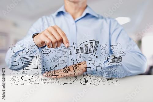 Leinwandbild Motiv Businessman and  analytics symbols on  background