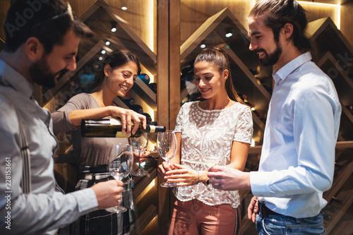 Zobacz obraz Happy couples taste wine in the restaurant
