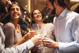 Happy couples taste wine in the restaurant - 228155092