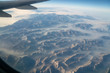 Quadro Aerial view of Sierra Nevada mountains filled with fire smoke. California at sunrise shot from an airliner
