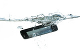 smartphone is falling into the water with splash, concept for waterproof product or insurance claim, isolated on a white background, copy space - 228158033