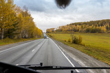 autumn view of the highway from the cab