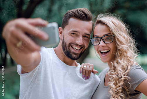 close up.smiling young couple taking selfie in city Park