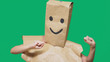 Leinwanddruck Bild - concept of emotions, gestures. a man with paper bags on his head, with a painted emoticon, smile, joy
