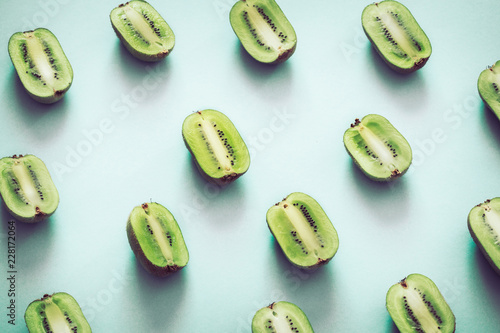 Fresh halves of kiwi on a blue background - 228172064
