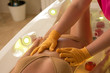 Quadro Beauty treatment for feet and legs. Hand massaging feet. Studio shot.