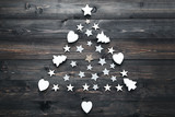 Stars in shape of christmas tree on wooden table - 228179882