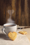 Cookies in the shape of a heart and coffee