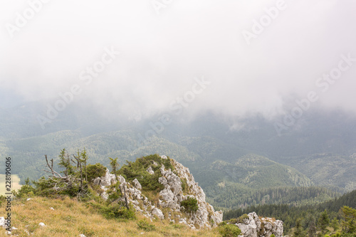 Mountain peaks and trails in summer time. Romania - 228190606