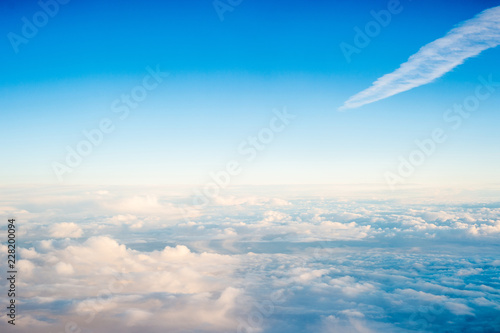 Top view of the cloud photo taking from airplane window - 228200094