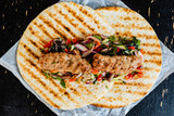 grilled kebab with salad - 228200290