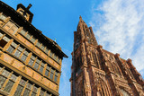 Strasbourg Cathedral beside a historical house - 228214638