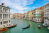 Gondola and a motor boat on the Grand Canal in Venice Italy