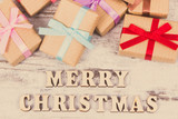 Gifts with ribbons and inscription Merry Christmas, festive time concept. Vintage photo