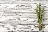 background rosemary on a wooden table. Spices and herbs. - 228244860