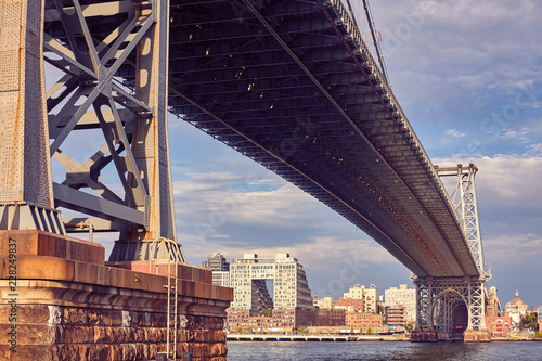 Foto Murales Vintage toned picture of Manhattan Bridge at sunset, New York City, USA.