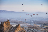 Unreal world of Cappadocia. Colorful sunrise in Red Rose valley in April. Cavusin village located, Nevsehir Province in the Cappadocia region of Turkey, Asia. Traveling concept background