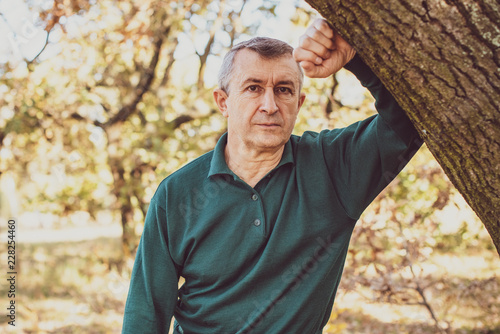 Leinwandbild Motiv Senior man with a sad philosophical mood worried about something. The concept of life after 50 years, problems and depression. Crisis of middle age
