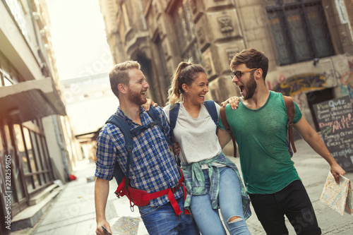 Young travelling people having fun in city