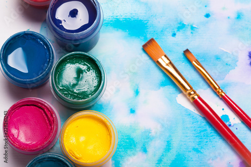 Top view of work process of watercolor paper pad, watercolor painting supplies and brushes © NewFabrika