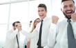 Leinwanddruck Bild - happy employees standing in spacious office