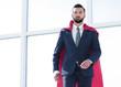 Leinwandbild Motiv Businessman in a red superhero cloak.