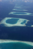 Blue and turqouise coral reef and atol, in the Maldives, aerial view, panorama from the air.