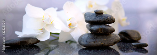 White orchids flowers and spa stones . Spa background. © Swetlana Wall