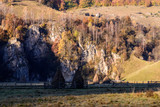 Autumn landscape in the mountains with stack of hay. Traditional hay stacks, typical rural scene of Fundatura Ponorului, Romania.  - 228286646