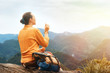Hiker woman blowing soap bubbles in mountains.