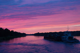 Big barge on the Volga at sunset - 228293614